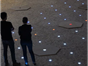 spot lighting on pavements with 2 people viewing it